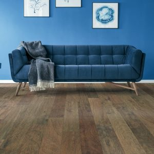 Blue couch on Hardwood flooring | We'll Floor You