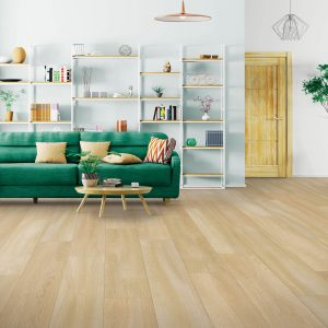 Green couch on Laminate flooring | We'll Floor You