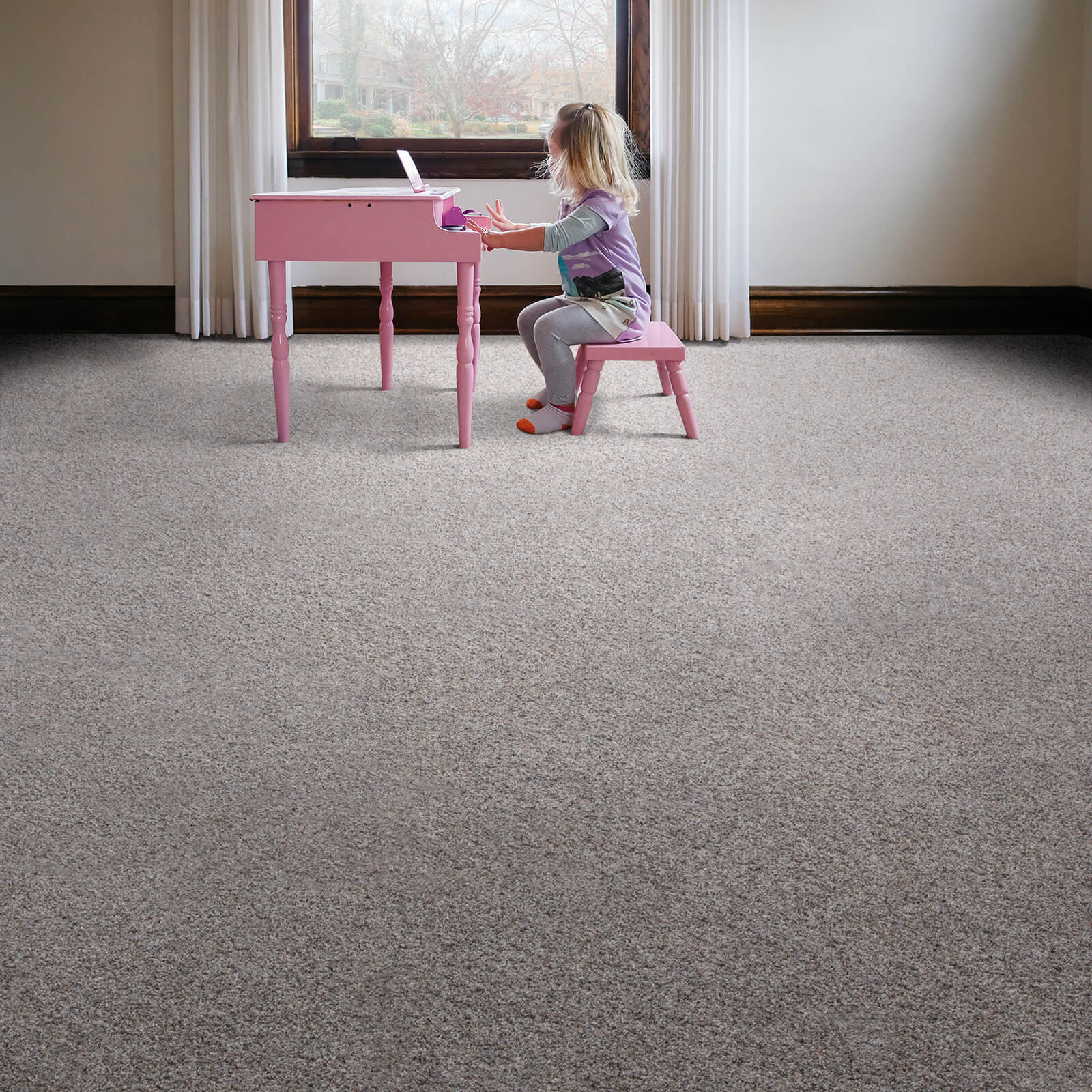 Girl with piano on carpet   We'll Floor You