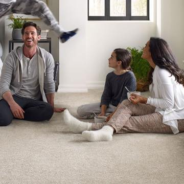 Family on carpet | We'll Floor You